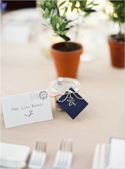 a wedding favor with a personalized midnight blue card attached