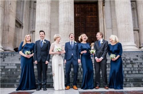 bridesmaids wearign super elegant midnight blue maxi dresses with high necklines and long sleeves
