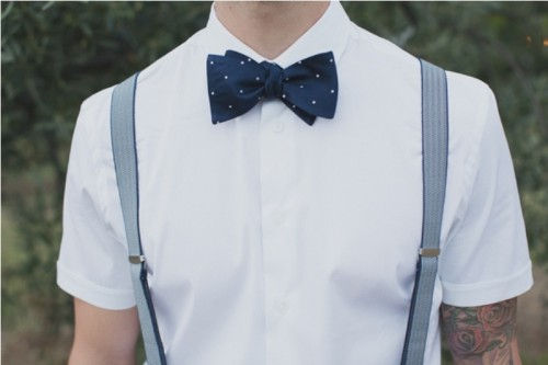 a polka dot midnight blue bow tie is a stylish idea to spruce up your groom's look