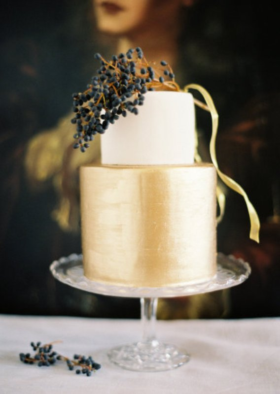 Picture Of A Shiny Gold And White Wedding Cake Topped With