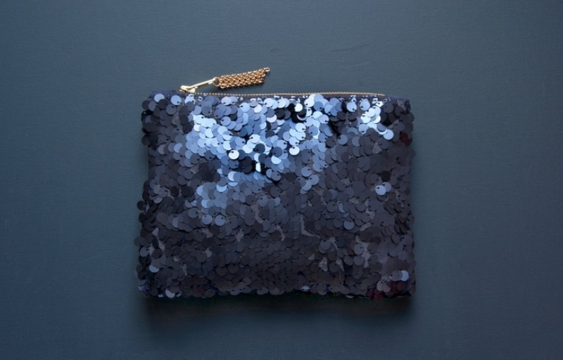 a large sequin midnight blue purse for carrying all your necessary things for the big day