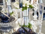 midnight blue plates and chargers and glasses add color to the space with a gentle feel
