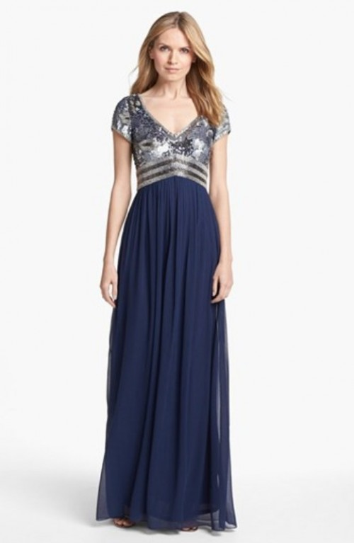 a midnight blue bridesmaid dress with a sequined silver bodice and a maxi pleated skirt