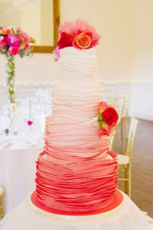 an ombre white to pink wedding cake with fresh bright blooms is a bold and cool idea for a modern bold wedding