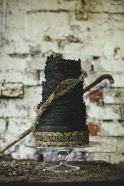 a black textural wedding cake with gold lace is a cool moody wedding dessert to try
