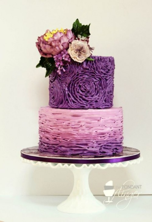 a textural purple wedding cake with a floral and an ombre ruffle tier plus fresh blooms and leaves on top