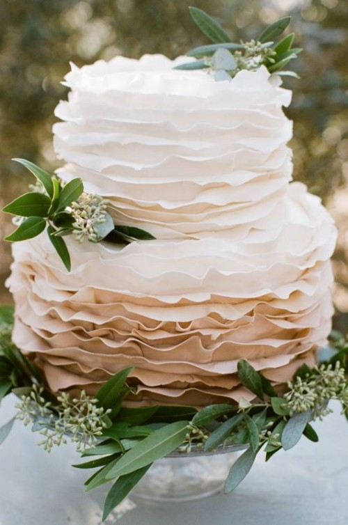a ruffle wedding cake with an ombre tier decorated with eucalyptus looks romantic and elegant