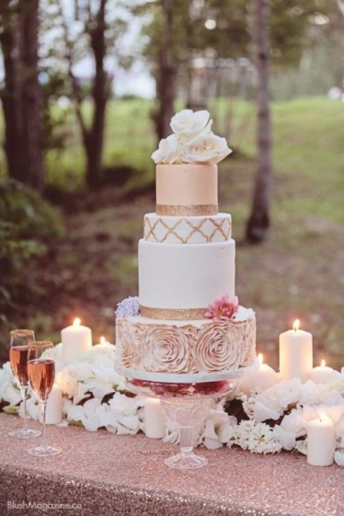 a romantic wedding cake with blush and white plain tiers, with a blush ruffle floral one and fresh roses on top