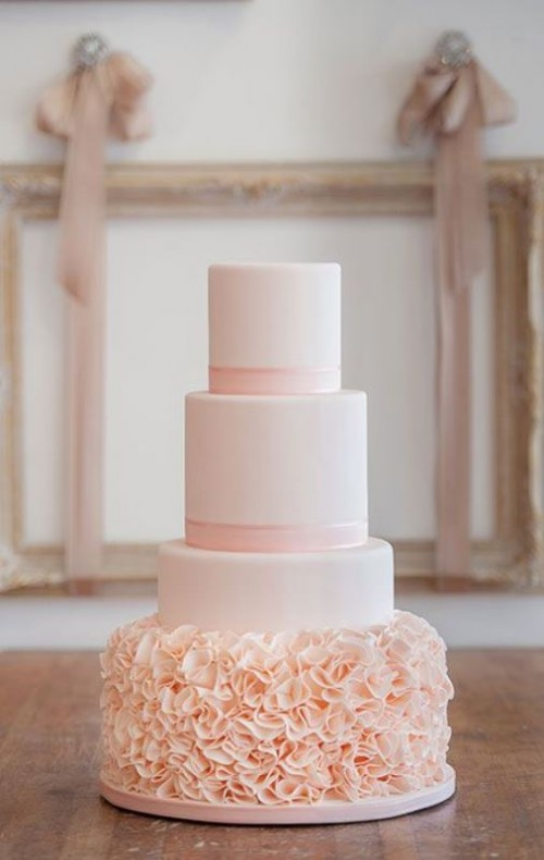 a blush wedding cake with ribbons and a floral ruffle tier is very romantic and very girlish