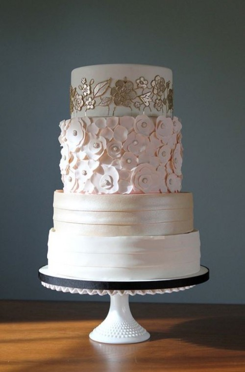 a refined wedding cake with striped tiers, floral ones in gold, white and pink