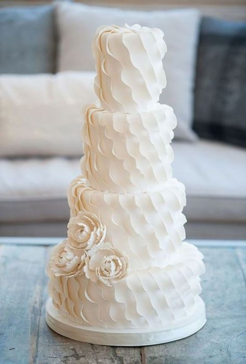 a white textural with ruffles and sigar blooms is a romantic and whimsical dessert idea