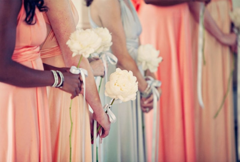 coral and mint maxi bridesmaid dresses and creamy blooms to carry for a chic and bold wedding