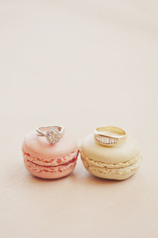 coral and creamy macarons can be used to show off your wedding rings or given as favors or desserts