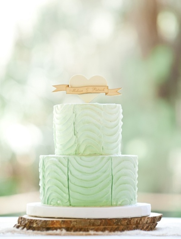 a pretty textural mint wedding cake with a white heart and a topper for a bold coral, mint and creamy wedding