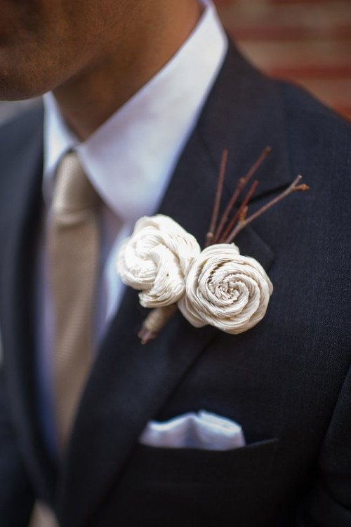 a creative wedding boutonniere of branches and fabric flowers is a very chic and eye-catchy idea to try