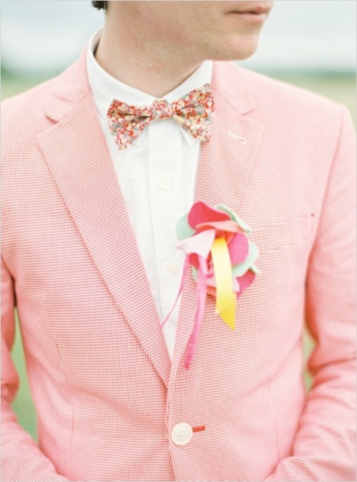 a colorful fabric boutonniere of pieces of fabric and ribbons is a fun idea that adds a playful touch to the outfit