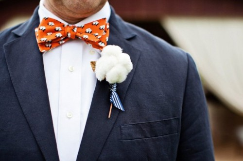a fluffy pompom wedding boutonniere with a striped ribbon is a lovely and fun idea with a touch of softness