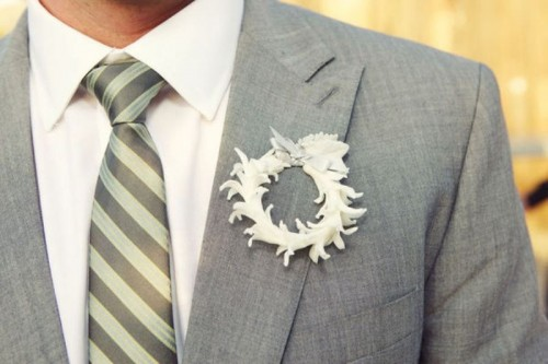 a paper flower wreath boutonniere with a bow on top is a fun and creative accessory with a touch of romance