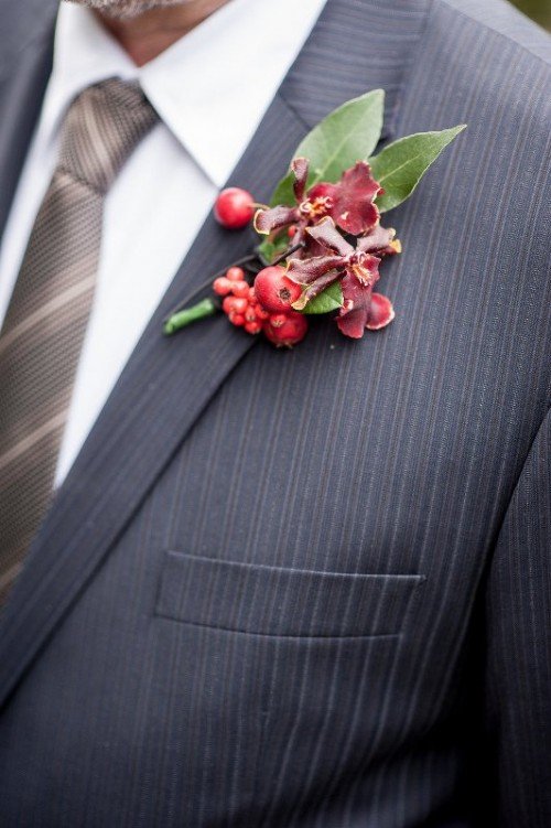 a sumptuous boutonniere of berris, bold blooms and foliage is a cool and bold idea for a fall groom
