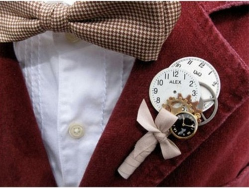 a vintage clock boutonniere with gears and a bow is a lovely idea for a steampunk wedding or a groom wo loves mechanics
