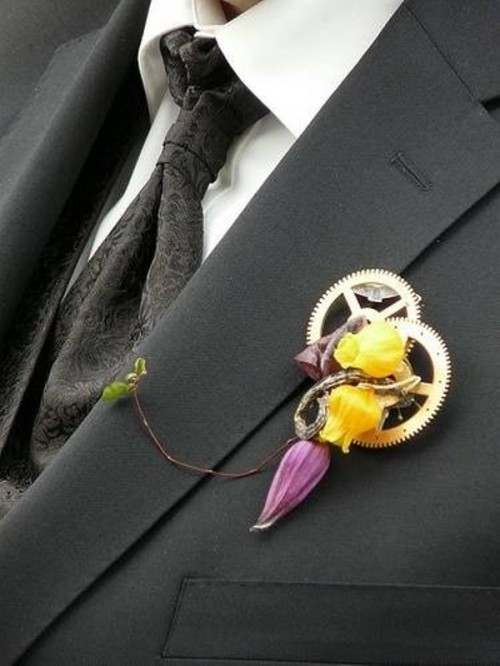 a steampunk wedding boutonniere of gears and bold blooms plus a twig is a very chic and statement-like idea for a steampunk wedding