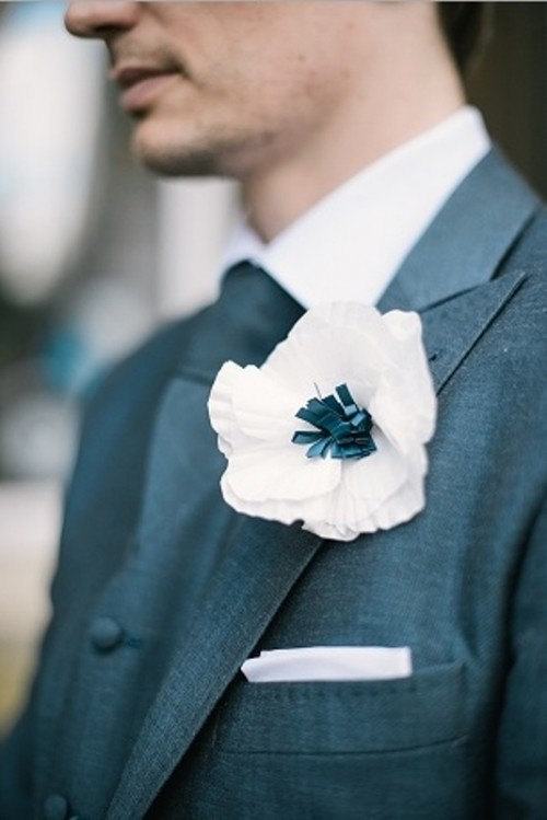 a large white paper anemone boutonniere is a fresh and very eco-friendly solution for those who want flowers