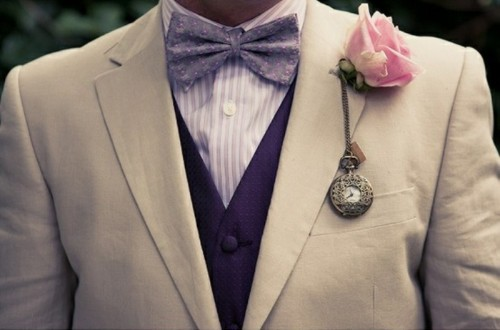 a cool wedding boutonniere with a vintage pocket clock and a pink rose is a very creative and bold idea
