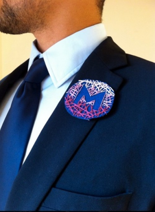 a very creative ombre embroidered wedding badge with a monogram is a unique alternative to a usual wedding boutonniere