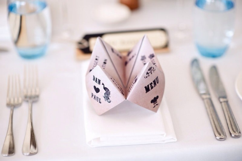 a folded paper menu is a creative idea to mark each place setting and give it a fun touch