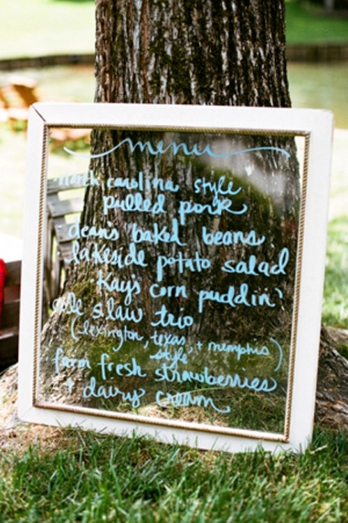 a window with a wedding menu is a simple and cool idea for a vintage or rustic wedding