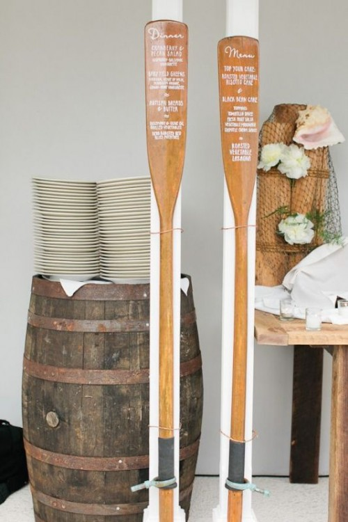 wooden oars with menus are very cool for fun and can be used for a river or lake wedding