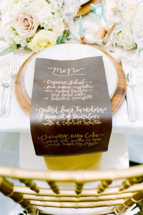 a faux leather menu with gold calligraphy will give a textural look and a refined touch to the space