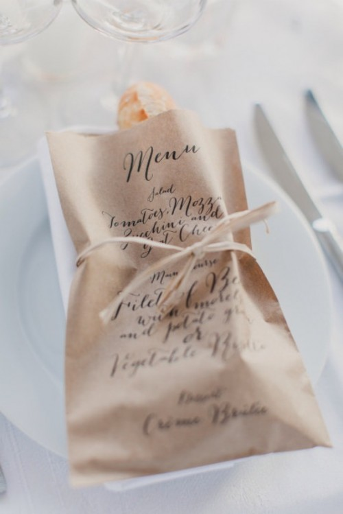 a kraft paper bag with a bagette is a fun and cute idea for a food-loving couple