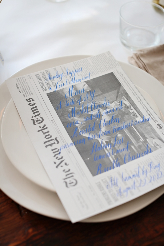 a wedding menu written with a bright blue pen right on the newspaper to make it retro and cool
