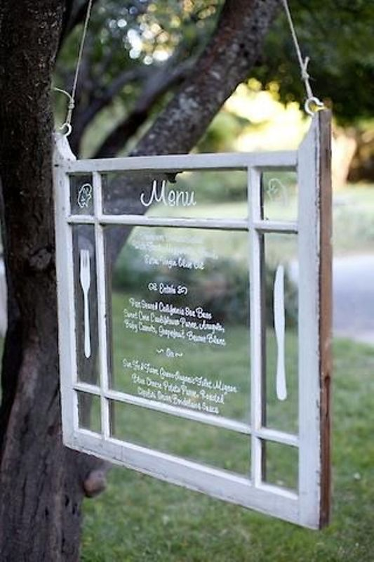 a vintage window menu hung on a tree is a great idea for a backyard or woodland wedding