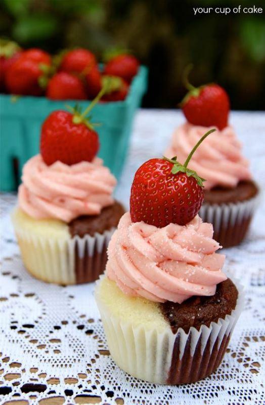 vanilla and chocolate cupcakes with pink icing and strawberries on top are delicious and fantastic