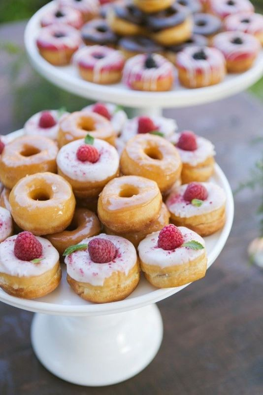 glazed donuts topped with raspberries are delicious and very tasty, they will fit a spring or summer wedding