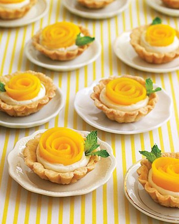 mini tarts with cream and peach sliced to form a flower are gorgeous for a summer wedding