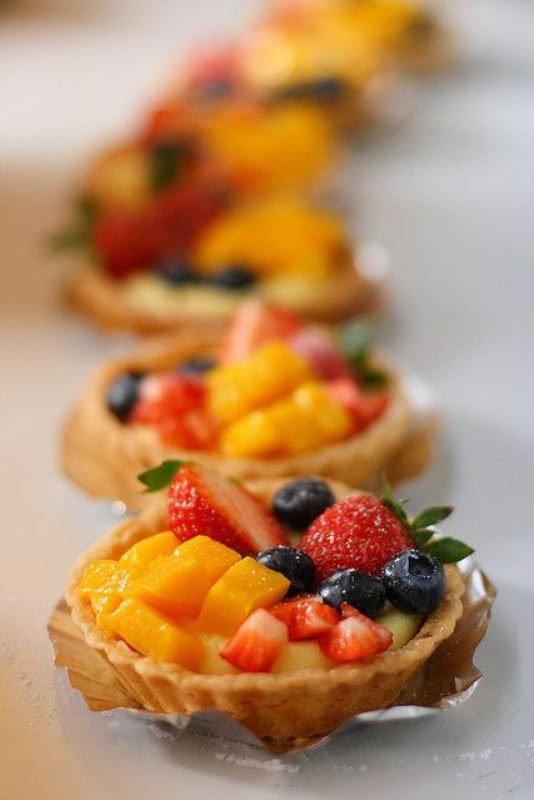 mini tarts with peaches, strawberries and blueberries plus custard are delicious for a summer wedding