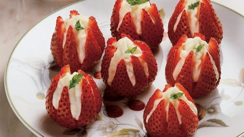 fresh strawberries filled with whipped cream are delicious and easy desserts for a spring or summer wedding