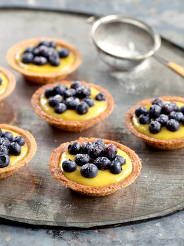 mini cups with custard and blueberries on top are a delicious wedding dessert for a summer or fall wedding