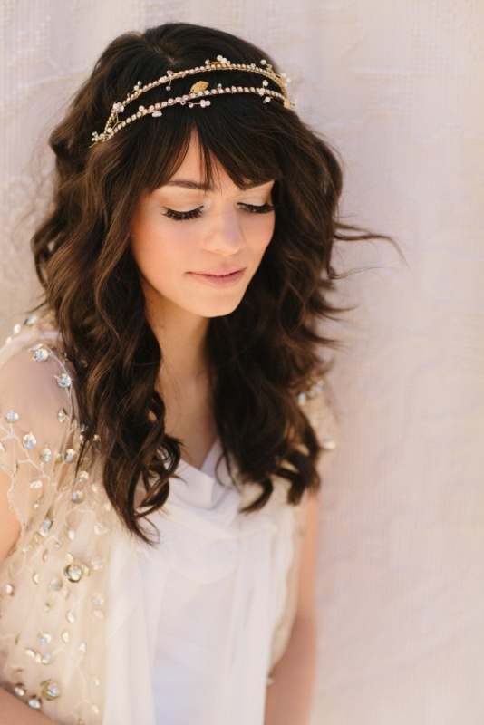 medium length waves down with a touch of mess plus bangs and a sparking headpiece