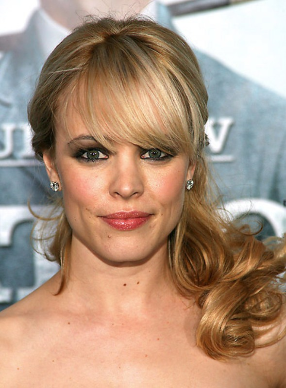 a long wavy half updo with bangs is a romantic option for the brides with long hair
