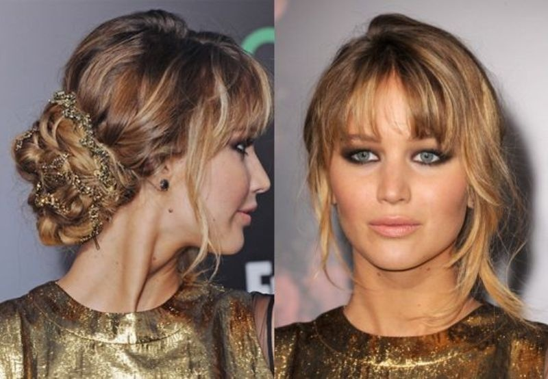 a wavy low chignon with a sparkling tie, a bump and wavy bangs is a trendy and messy idea