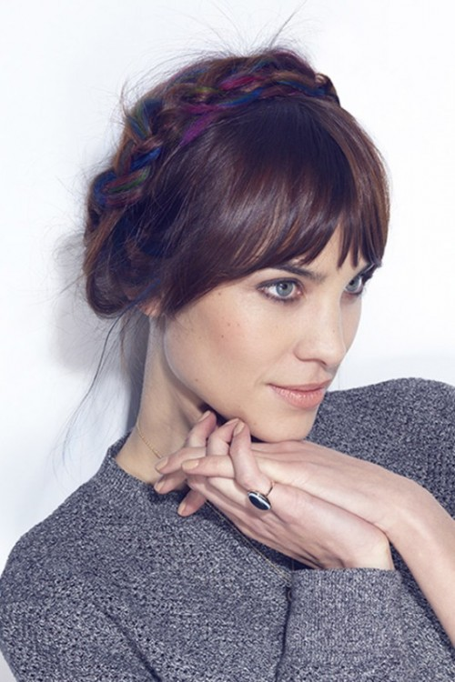 an updo with a colorful braid on top and bangs will add a touch of color to your look