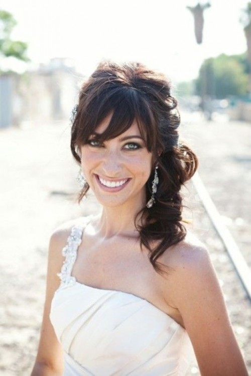 a wavy side half updo with bangs and a bump is a chic idea with a touch of vintage