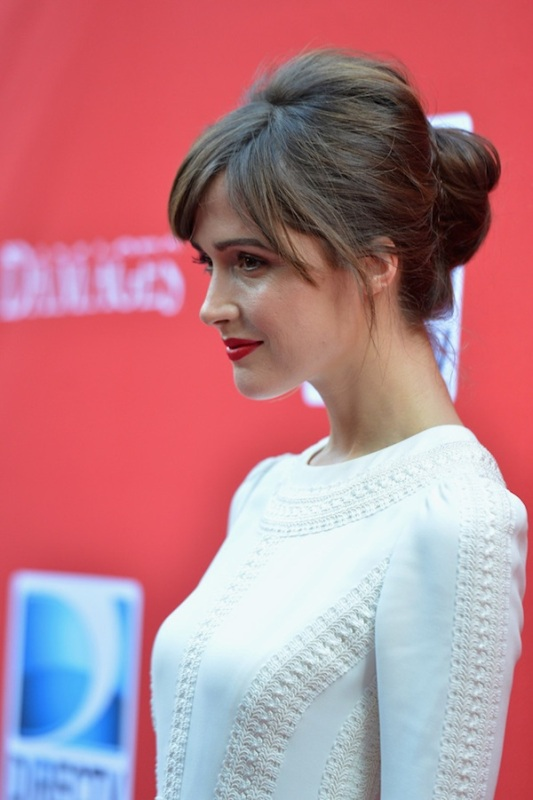a chignon with a bump and bangs is a cool idea for many bridal styles and fits long and medium length hair