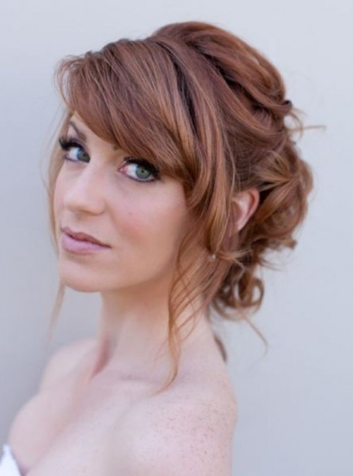 a romantic wavy updo with a bump and side bangs is a timeless idea with a vintage feel