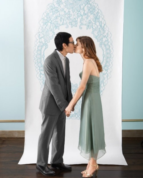 a beautiful handpainted wedding backdrop in pastel blue is a stylish idea and can be DIYed by any of you