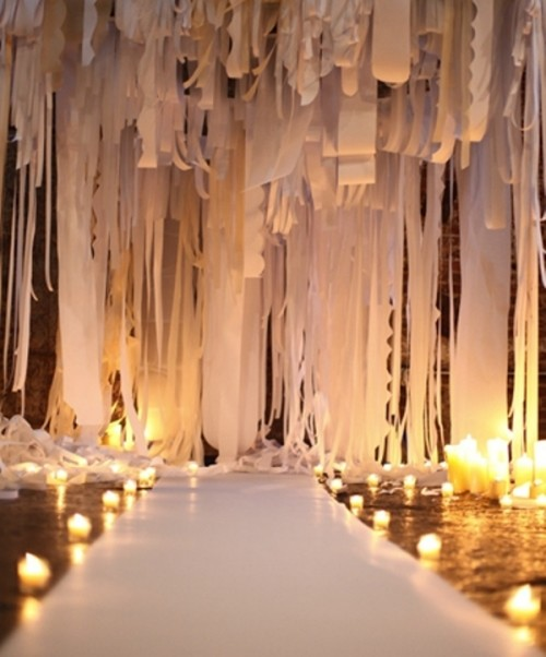 a dreamy white fabric ribbons, fabric and paper ribbons backdrop plus candles on the floor